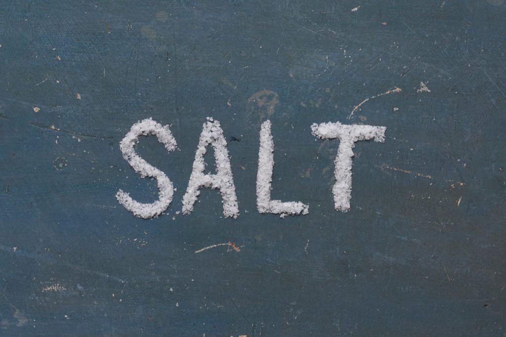 salt written on a black background in salt