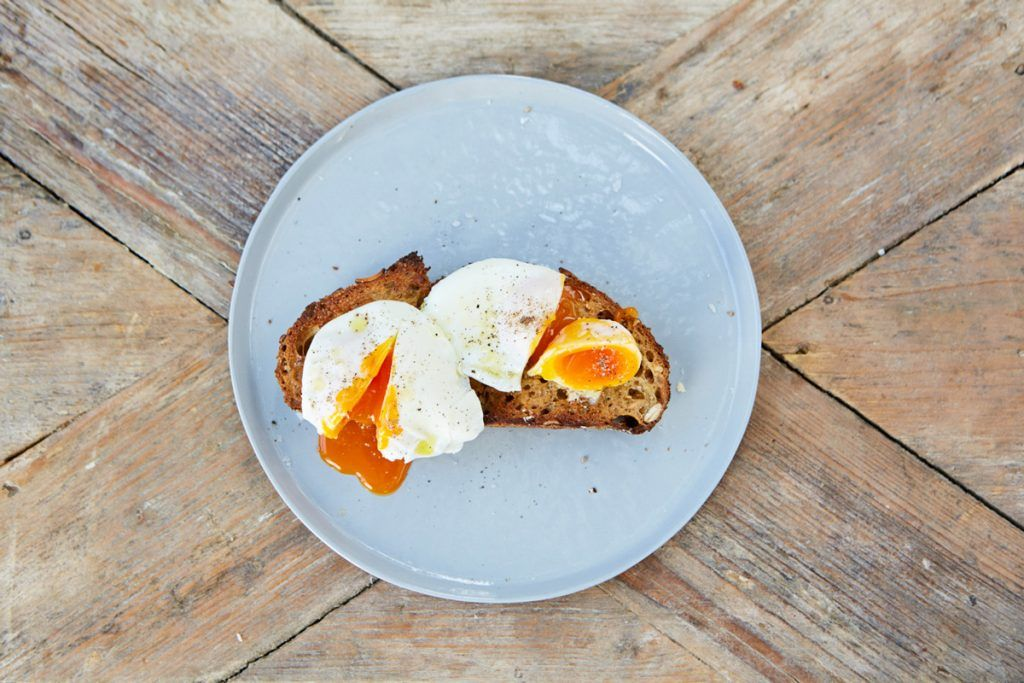 poached eggs cut in half on bread