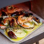 an array of seafood cooked in butter and lemon