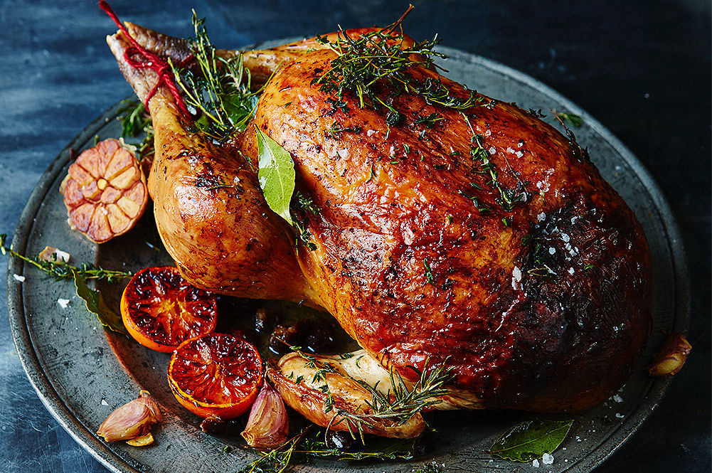 perfect turkey for christmas day with lemon and herbs on top