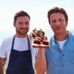 jamie and chef cooking black pudding recipes on a wooden tray