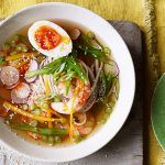 asian prawn and noodle soup with boiled egg and spring onions