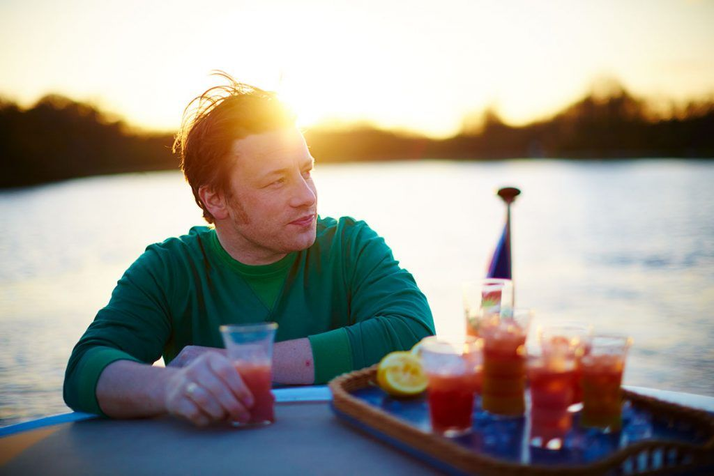 jamie on a boat sipping a cocktail in the sunset