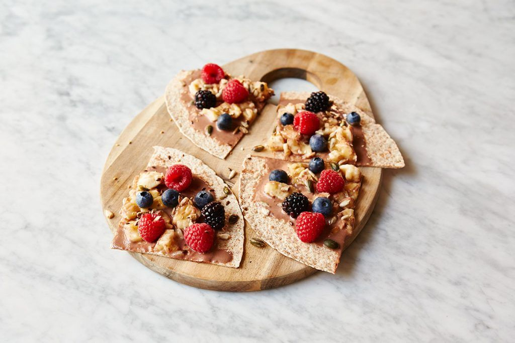 breakfast fruit recipe with fruit and nuts on top of wraps