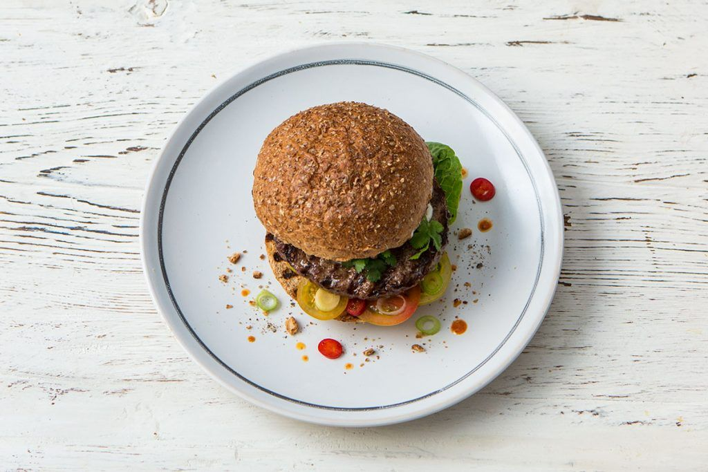 mexican style beef burger with chilli and tomatoes