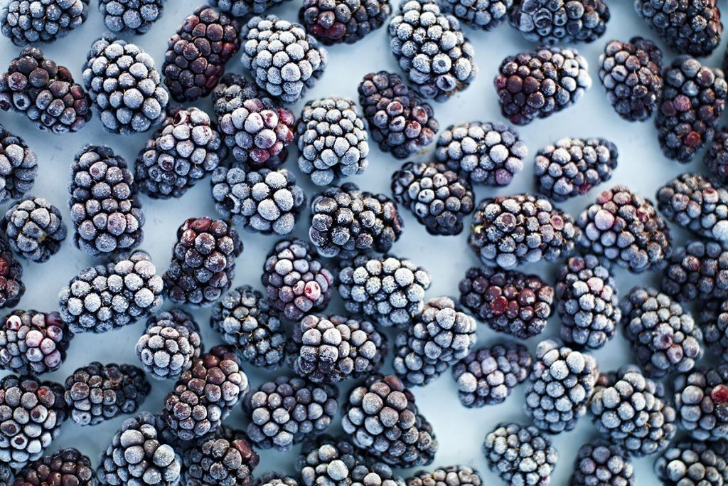 frozen blackberries scattered flat lay
