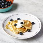 pancakes with blueberries and cream on top