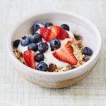 bowl of healthy oats with berries and yoghurt on top
