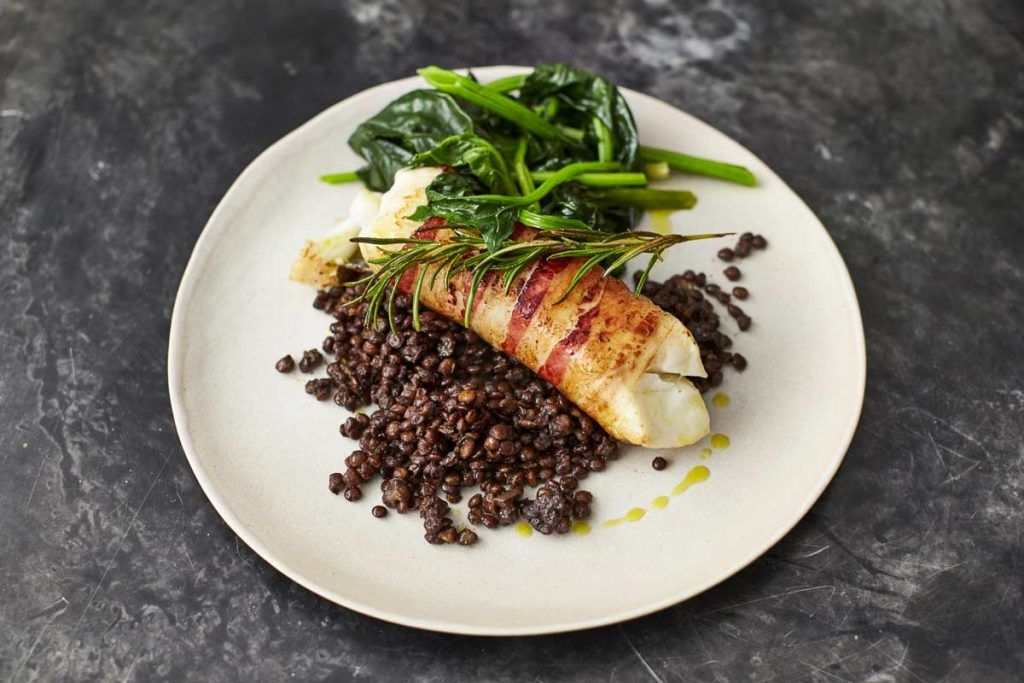 dairy-free pancetta wrapped around cod with lentils