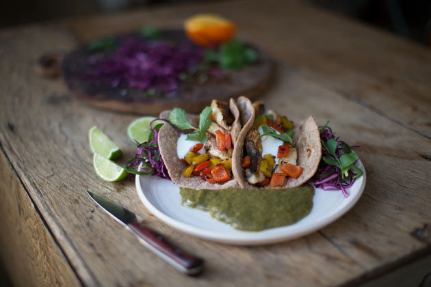 fish tacos with veg and sour cream and salad on the side