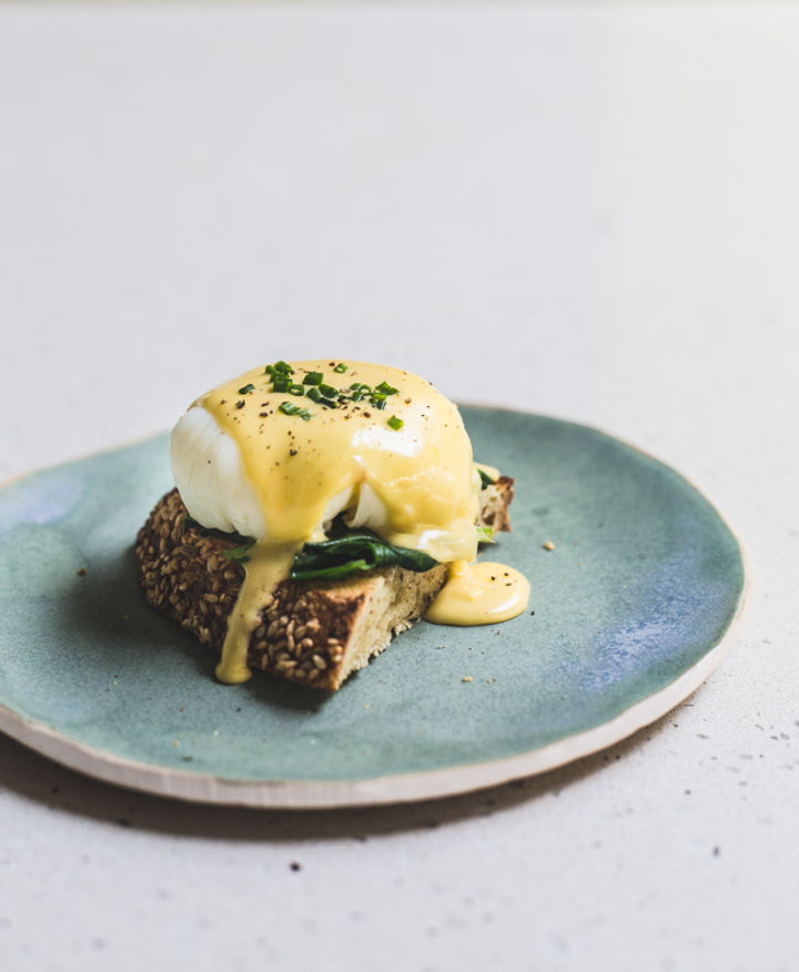 Image of perfect hollandaise drizzled over a poached egg on toast
