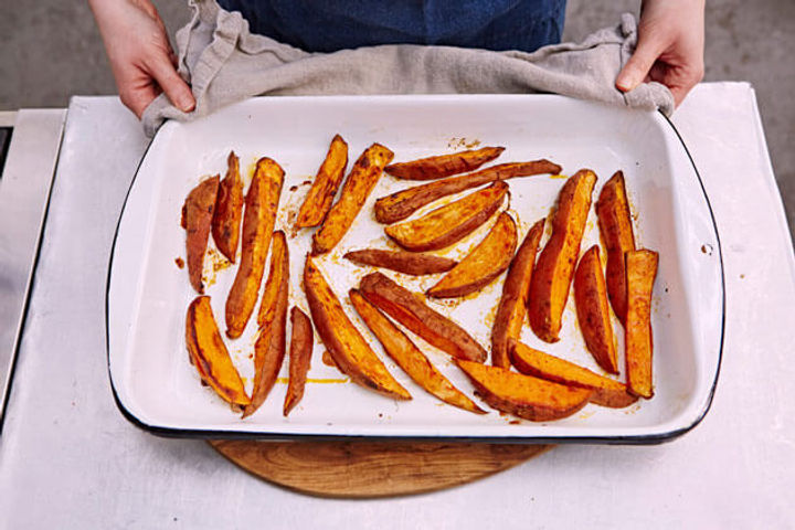 Image of cooked sweet potato fries on a baking tray