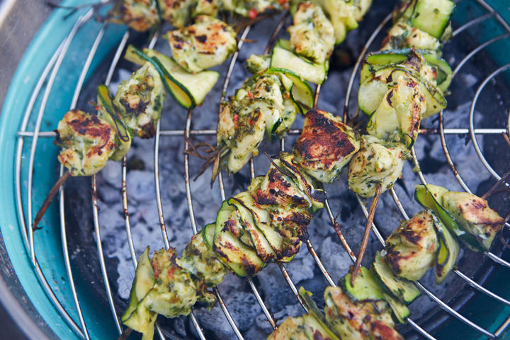 Image of marinaded kebabs cooking on a BBQ