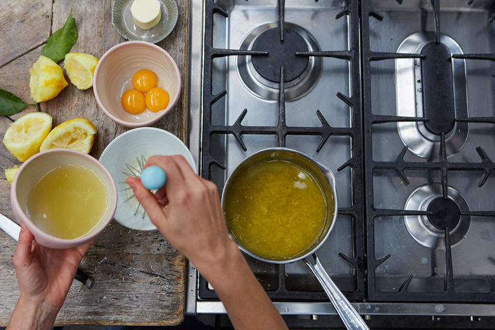 Image of lemon juice being whisked into the bowl of cornflower paste