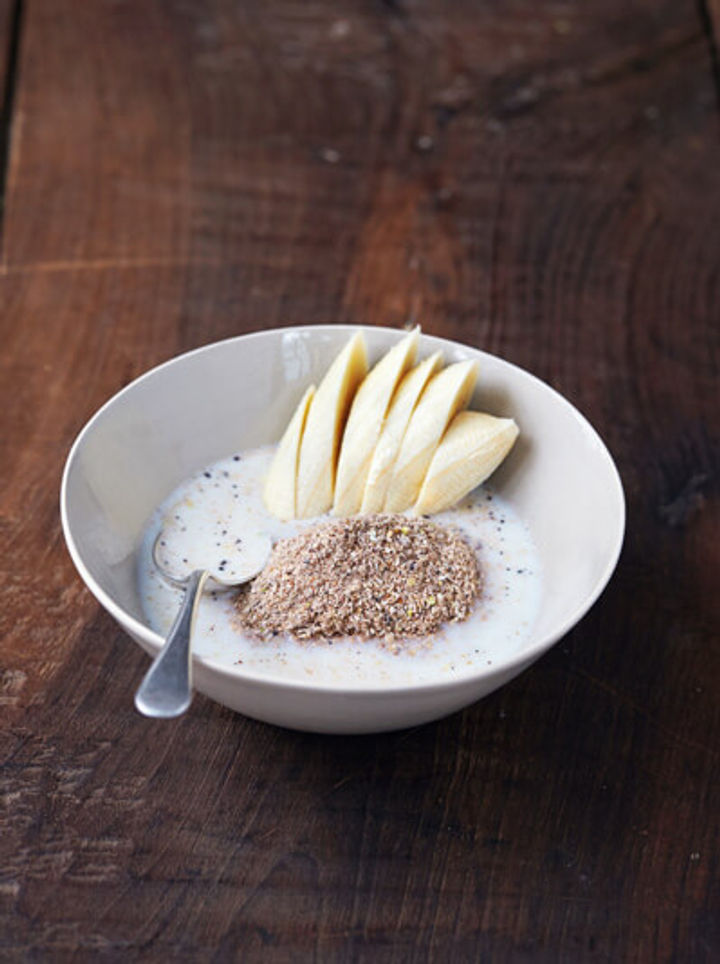 bowl of granola dust with banana and milk