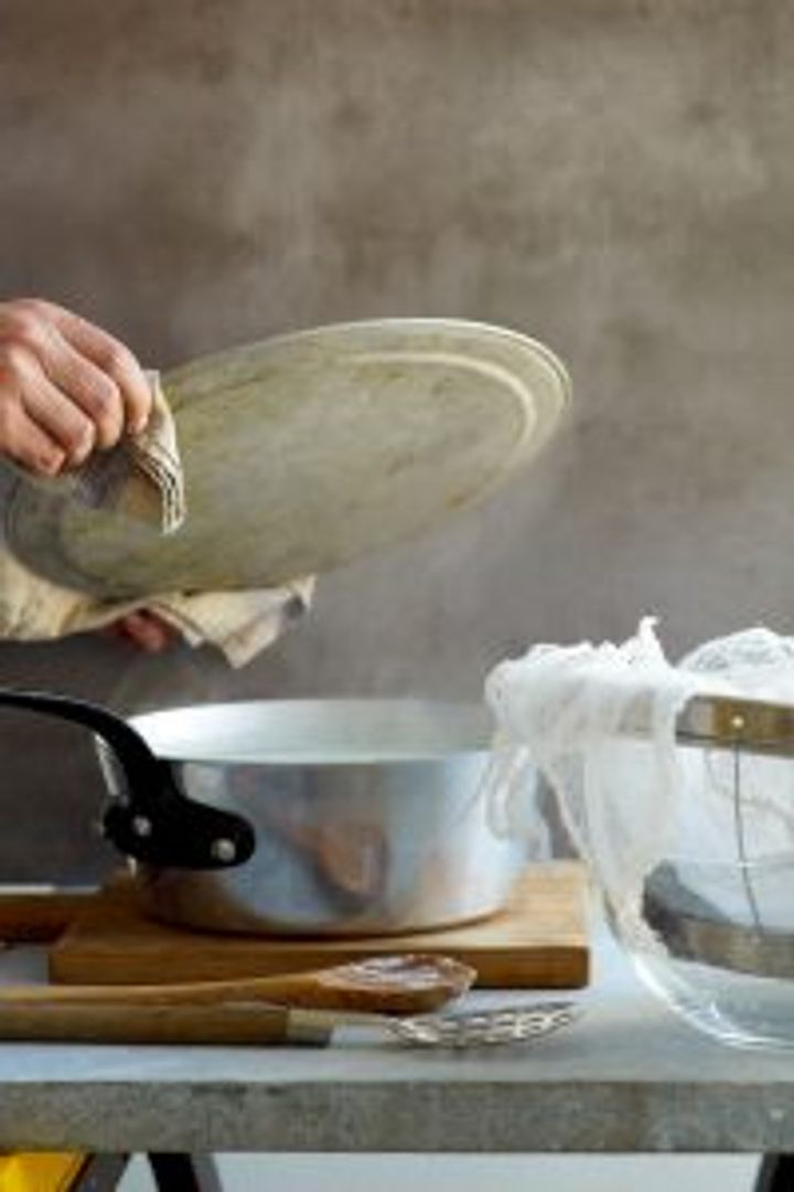 Put muslin in the strainer