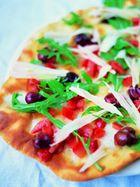 Olive, tomato, rocket, Parmesan & mozzarella pizza