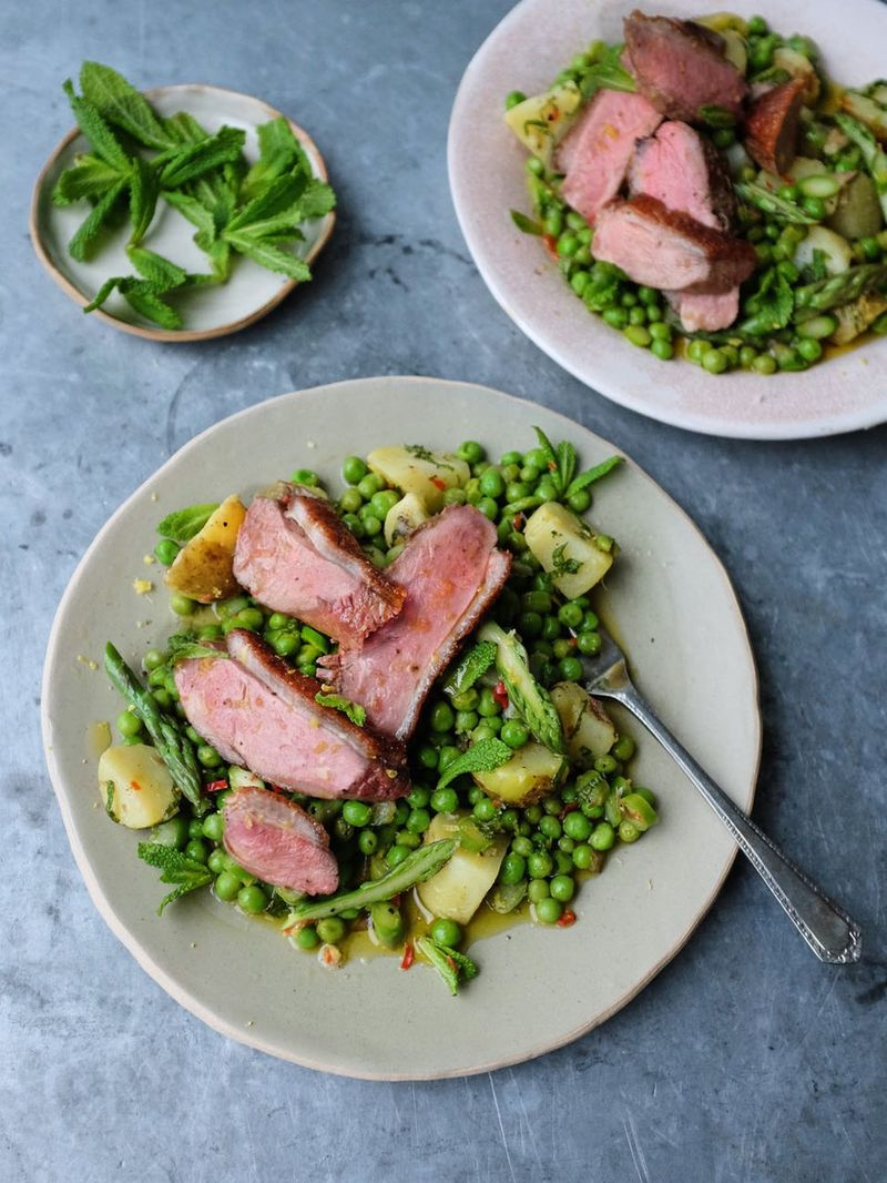 Pan-fried duck breast with spring veg