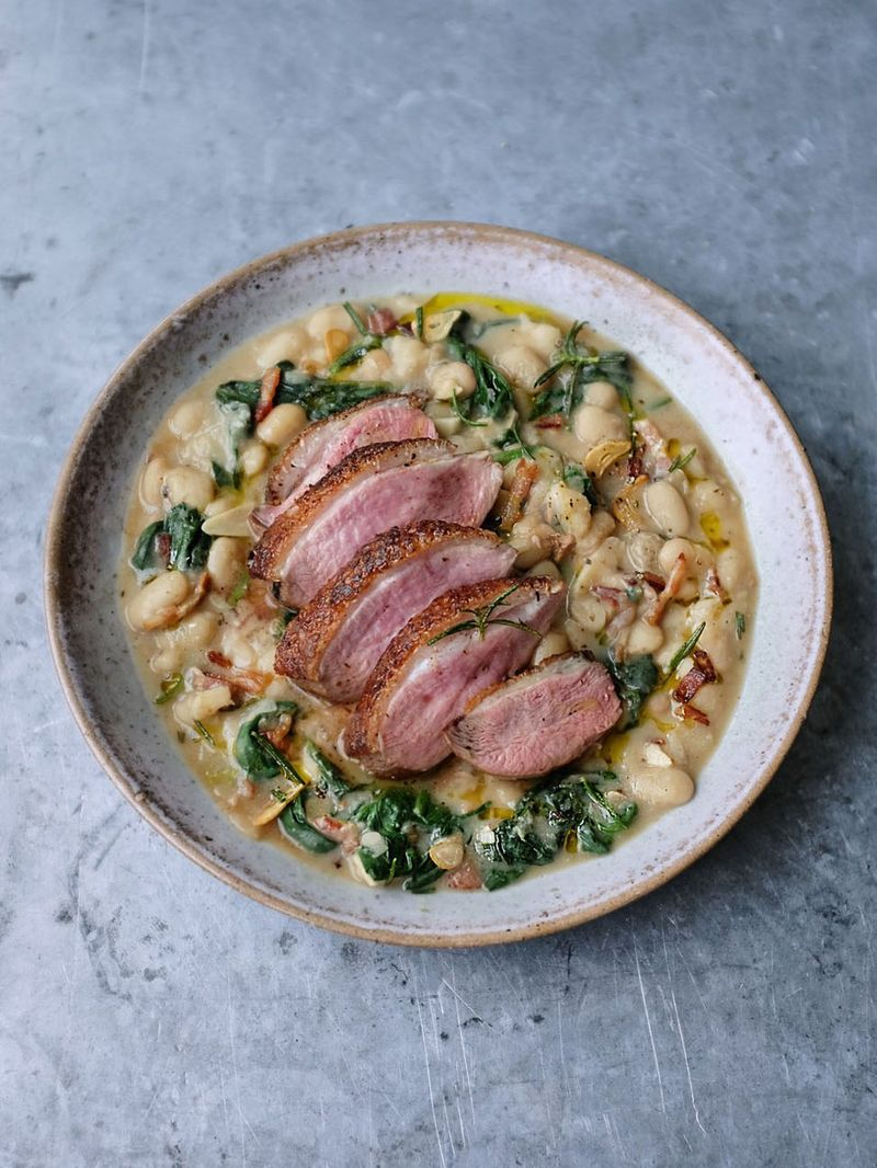 Pan-fried duck breast with creamy white beans
