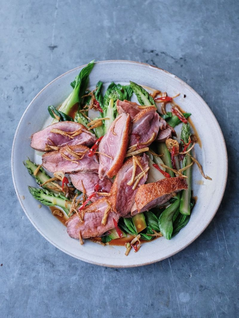 Pan-fried duck breast with pak choi & asparagus