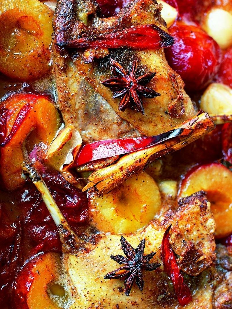 Sweet duck legs cooked with plums and star anise