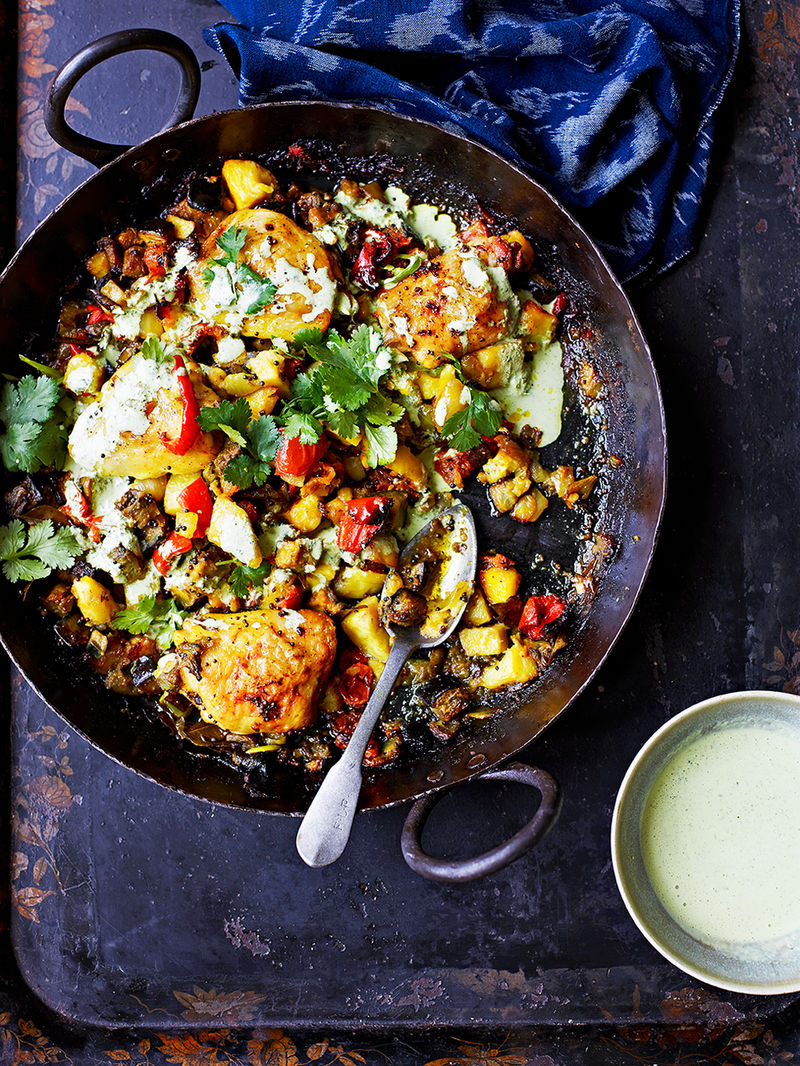 Indian-spiced potatoes with chicken thighs