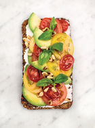 Avocado on rye toast with ricotta