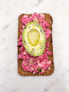 Avocado on rye toast with beetroot