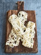 Roti jala (lace crêpes)