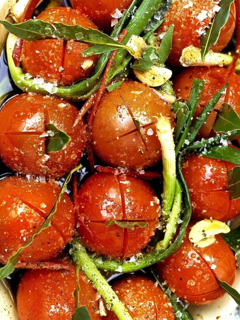 Slow-roasted balsamic tomatoes with baby leeks and basil