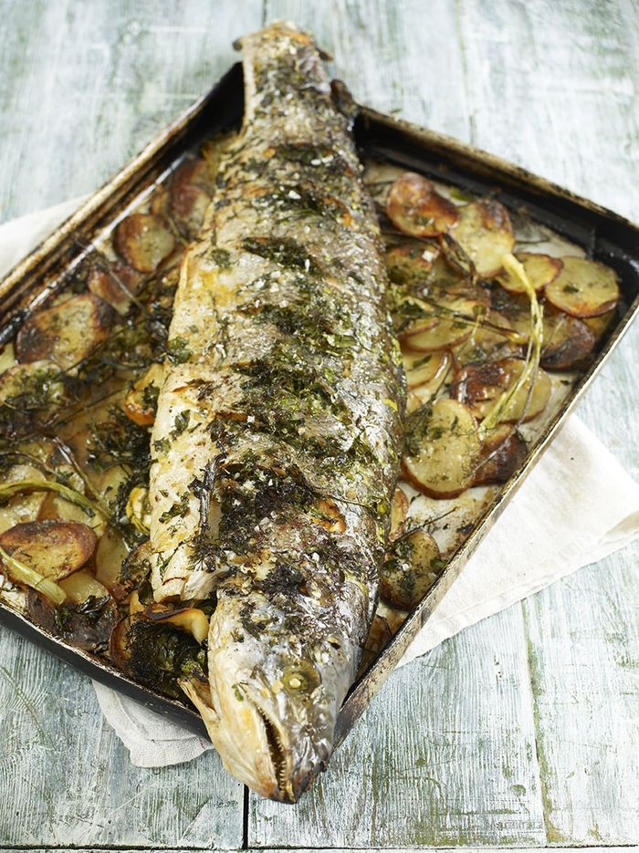 Whole roasted salmon stuffed with lemon and herbs