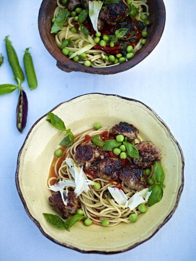 Quick sausage meatballs with a tomato & basil sauce, spaghetti & sweet raw peas