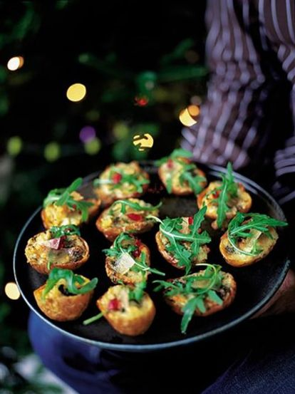 Baked potato skins with gorgonzola, rocket and mustard fruit