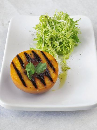 Warm grilled peach & frisée salad with goat's cheese dressing
